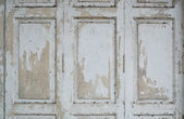 Paint peeling wooden door — Stock Photo