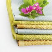 Stack of Thai fabric and Bougainvillea flowers — Stock Photo