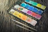 Water color paint box and paint brush — Stock Photo