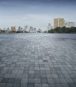 An empty scene of a stone tile floor and Bangkok city — Stock Photo