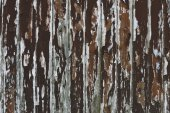 Paint peeling wooden old wall — Stock Photo