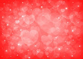 Red heart bokeh, love background — Stock Photo