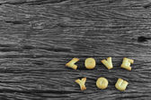 Image of Love You made from cookie on wooden board — Stock Photo