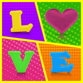 Love word and heart shape on colorful background — Stock Photo