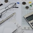 Calculator, pen, account book, glasses and coin on paper chart, — Stock Photo #68955555