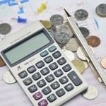 Calculator, pen, pin and coin on saving book — Stock Photo #69411523