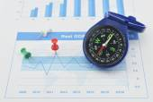 Blue compass and pin on graph paper, success concept — Stock Photo