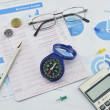 Compass, pen, glasses and calculator on saving book, investment  — Stock Photo #72315095