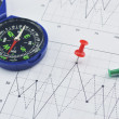 Red pin and compass on graph paper, success concept — Stock Photo #72434837