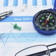 Red pin and compass on graph paper, success concept — Stock Photo #72873889
