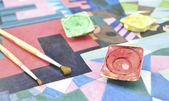 Messy used water color paint box and paintbrush — Stock Photo