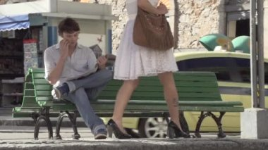 Girl Takes Seat Next To Guy — Stock Video