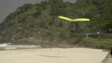 Hang Glider Landing On Beach — Stock Video