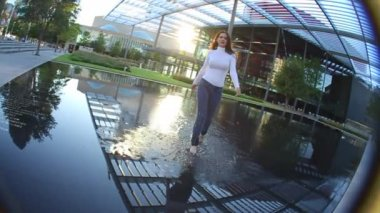 Woman Walks Through Reflection Pool — Stock Video