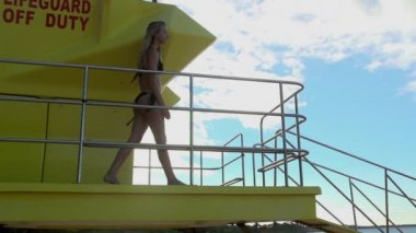 Woman on a Lifeguard Stand — Stock Video