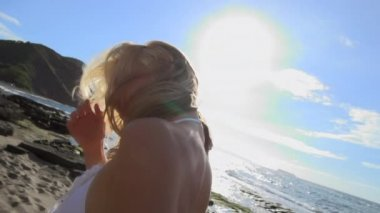 Young blond model posing on beach — Stock Video