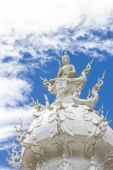 The White buddha status on blue sky background, northern Thailand — Stock Photo