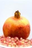 Fresh pomegranate on white background — Stock Photo