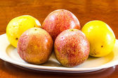 Passionfruits on white dish. — Stock Photo