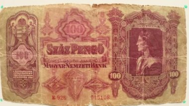 Paper money 100 Pengo Magyar Budapest in 1930 on a white table flipped a hand close up portrait Matias Kirali — Stock Video