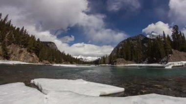 Dolly shot of clouds formation at Bow River — Stock Video