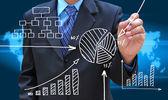 Businessman hand drawing business graph — Foto de Stock