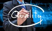 Businessman hand writing quality — Stock Photo
