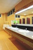 Handbasin and mirror in toilet — Stock Photo