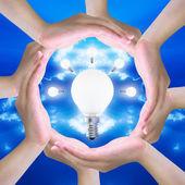 Light bulb in women hand — Stock Photo