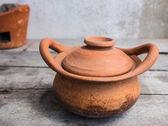 Clay pot on table — Stock Photo