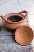Clay pot on wooden — Stock Photo