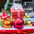 Red balls and gift — Stock Photo #58083437