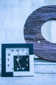 Clock on a wooden — Stock Photo