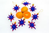 Tangerines and decorative stars on snow — Stock Photo
