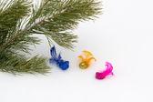 Pine branch with decorative multi-coloured birds  — Stock Photo