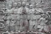 Relief picture of chinese workers on stone — Stock Photo