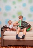 Musical ensemble of two brothers — Stock Photo