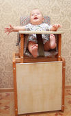 Adorable baby on highchair, at home — Stock Photo