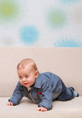 Baby try to creep on couch — Foto Stock