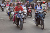 People are riding on motorcycles in Hanoi, Vietnam — Stock Photo