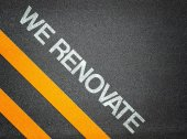 We renovate - Text Writing Road Asphalt — Stock Photo