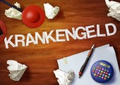 Krankengeld desktop memo calculator office think organize — Stock Photo