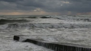 Waves of the Black sea during a storm breaking on the pier in Sochi — Stock Video