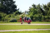 Red gyroplane taking off — Stock Photo