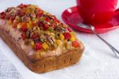 Cake with candied fruits and nuts — Stock Photo