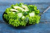 Fresh green salad with avocado, cucumber and broccoli — Stock Photo