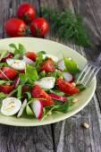 Salad with tomatoes, eggs, arugula and radish — Stock Photo