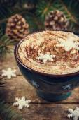 Cup of coffee with whipped cream and cocoa pwder — Stock Photo