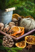 Christmas decoration. Dried oranges, pinecone and nuts. — Stock Photo