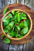 Fresh chard leaves in wooden bowl — Stockfoto